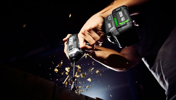 """FLEX ¼"""" Quick Eject Hex Impact Driver with Multi-Mode in use"""
